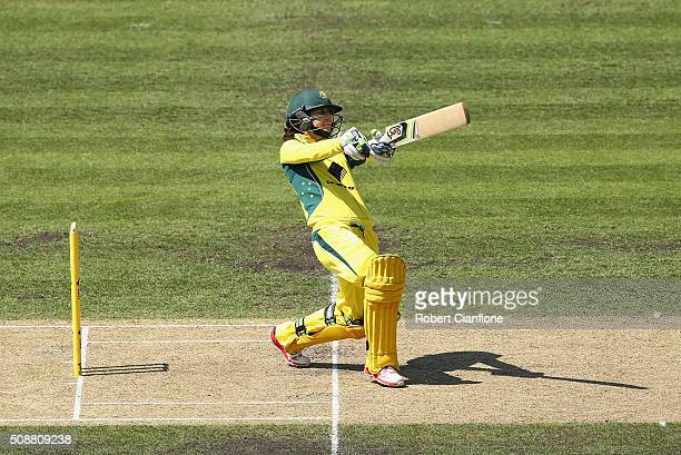 Nicole Bolton of Australia hits out during game three of the one day international series between Australia and India at Blundstone Arena on February...