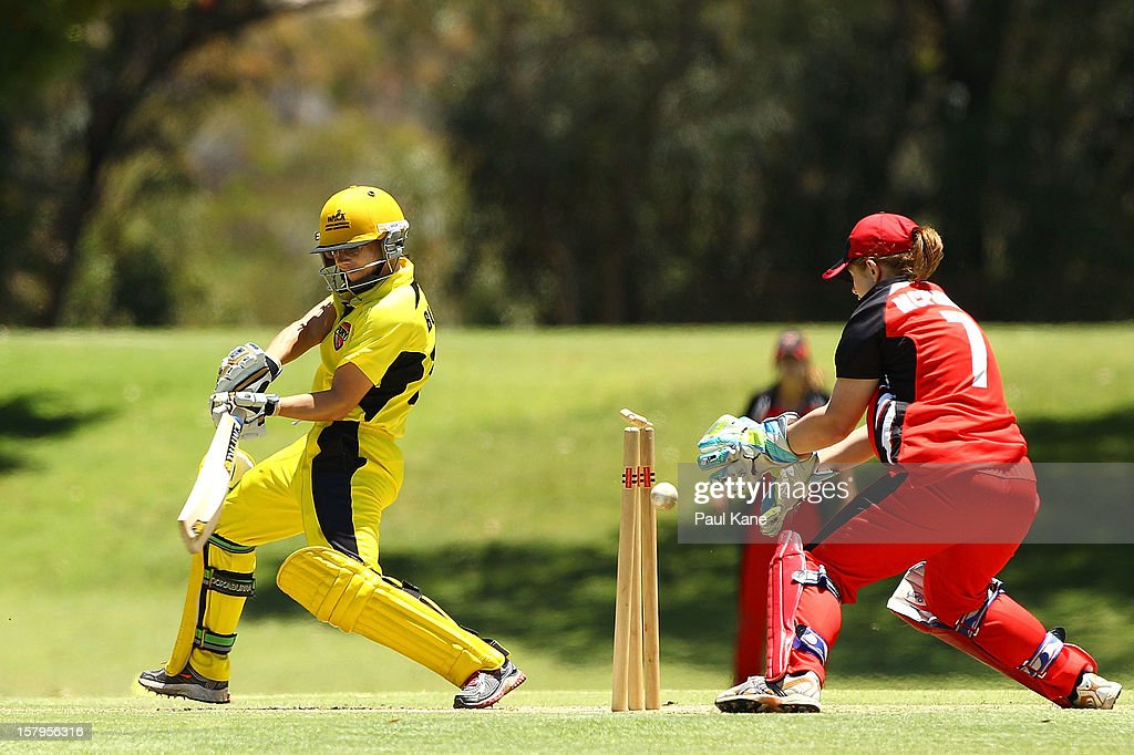 Nicole Bolton of the Fury gets bowled by Alex Price of the Scorpions during the WNCL match between the Western Australia Fury and the South Australia Scorpions at Christ Church Grammar Playing Fields on December 8, 2012 in Perth, Australia.