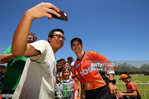 Nicole Bolton of the Scorchers poses with a supporter for a selfie after winning the Women's Big Bash League match between the Melbourne Stars and...