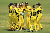 Nicole Bolton of Western Australia is congratulted by team mates after the runout of Sarah Taylor of South Australia during the round one WNCL match...