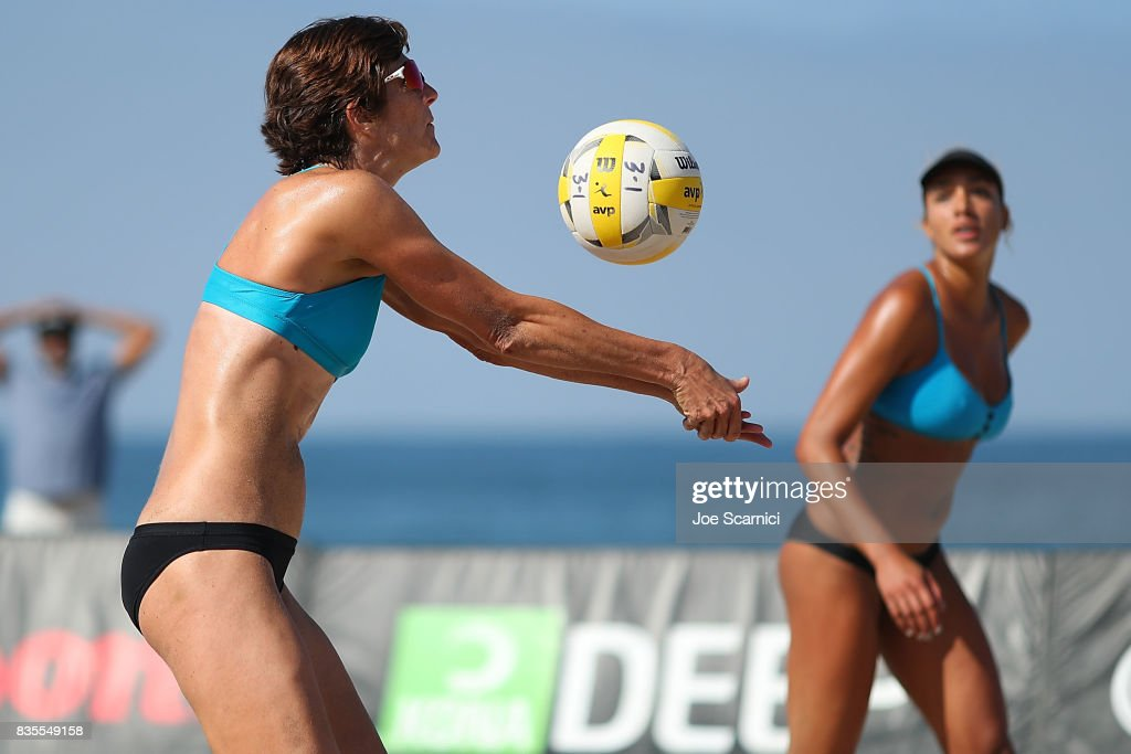 Nicole Branagh sets the ball for Brandie Wilkerson during their round 3 match at the AVP Manhattan Beach Open - Day 3 on August 19, 2017 in Manhattan Beach, California.
