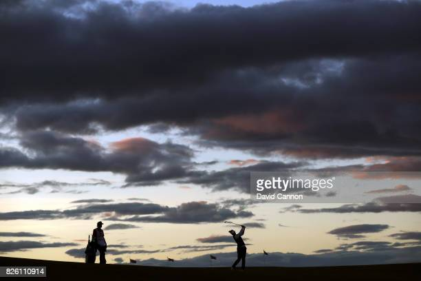 Nicole Broch Larsen of Denmark plays her approach shot to the 17th hole as the light fades during the first round of the Ricoh Women's British Open...