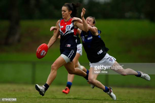 Nicole Callinan of Darebin Falcons gets tackled by Ellie Blackburn of Melbourne Uni during the round one VFL Women's match between the Darebin...
