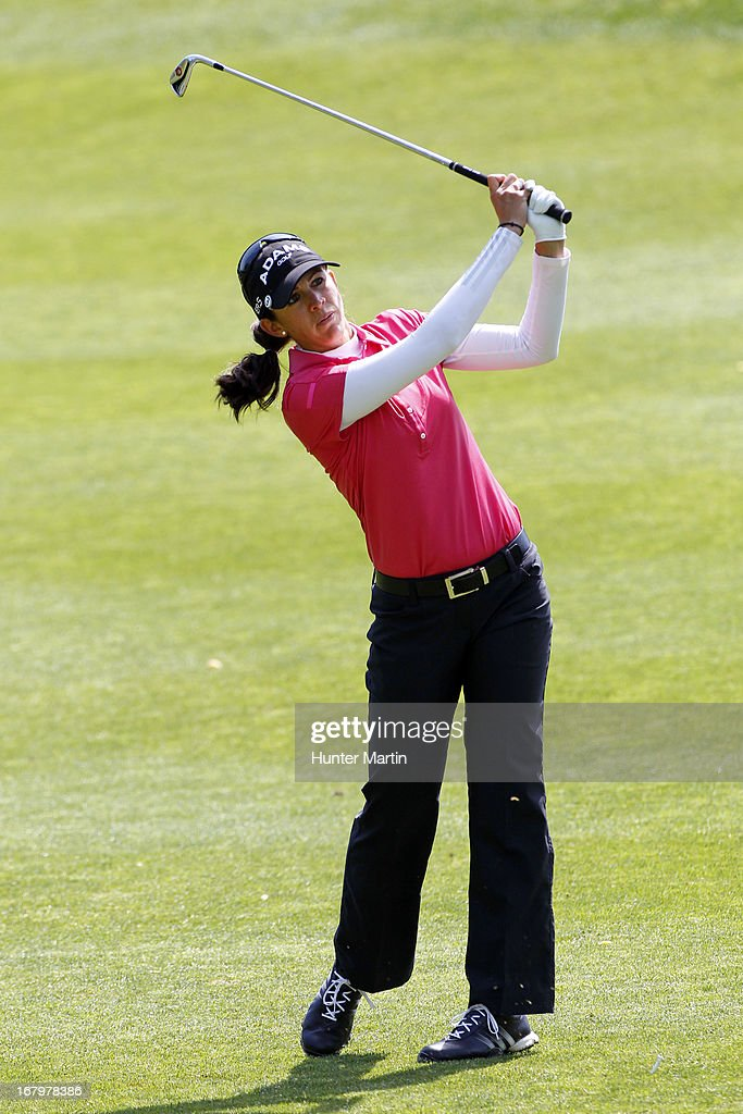 <a gi-track='captionPersonalityLinkClicked' href=/galleries/search?phrase=Nicole+Castrale&family=editorial&specificpeople=576165 ng-click='$event.stopPropagation()'>Nicole Castrale</a> hits her second shot on the eighth hole during the second round of the Kingsmill Championship at Kingsmill Resort on May 3, 2013 in Williamsburg, Virginia.