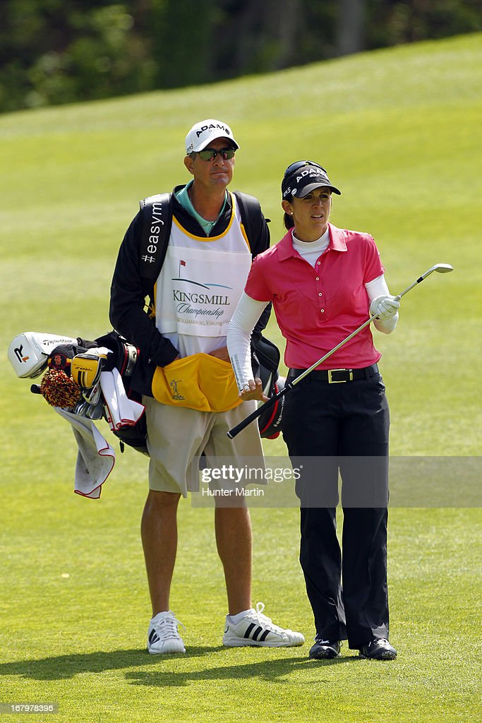 <a gi-track='captionPersonalityLinkClicked' href=/galleries/search?phrase=Nicole+Castrale&family=editorial&specificpeople=576165 ng-click='$event.stopPropagation()'>Nicole Castrale</a> stands in the fairway with her caddie on the eighth hole during the second round of the Kingsmill Championship at Kingsmill Resort on May 3, 2013 in Williamsburg, Virginia.