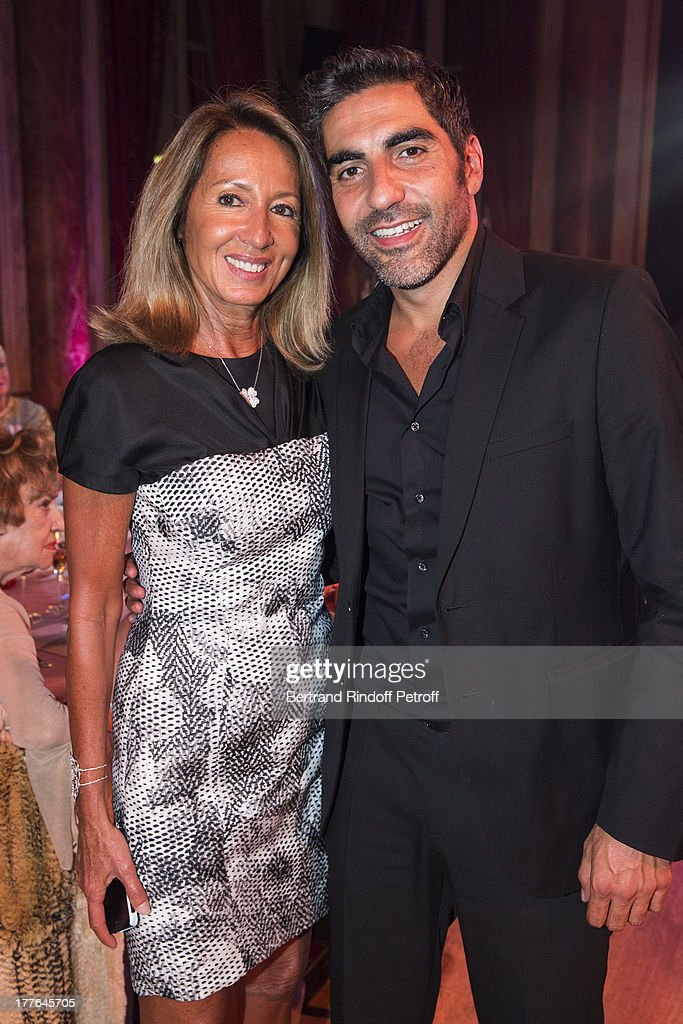 Nicole Coullier (L) and humorist Ary Abittan attend the Grand Bal Care in Deauville on August 24, 2013 in Deauville, France. Care France, the French branch of the humanitarian aid organization Care, was celebrating its 30th anniversary on Saturday.