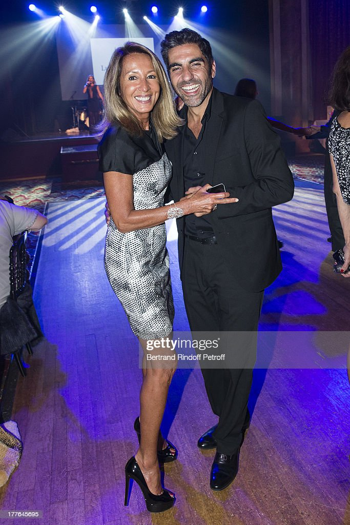Nicole Coullier (L) and humorist Ary Abittan dance during the Grand Bal Care in Deauville on August 24, 2013 in Deauville, France. Care France, the French branch of the humanitarian aid organization Care, was celebrating its 30th anniversary on Saturday.