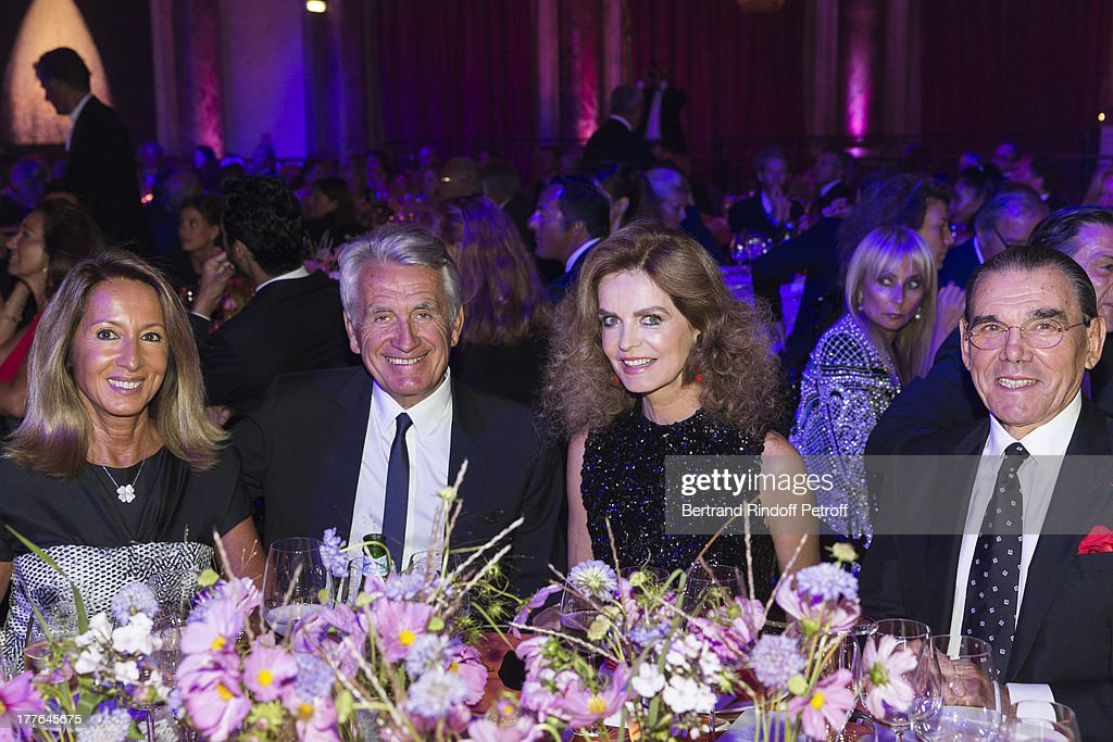 Nicole Coullier, her husband Gilbert Coullier, Cyrielle Clair and her husband Michel Corbiere attend the Grand Bal Care In Deauville on August 24, 2013 in Deauville, France. Care France, the French branch of the humanitarian aid organization Care, was celebrating its 30th anniversary on Saturday.