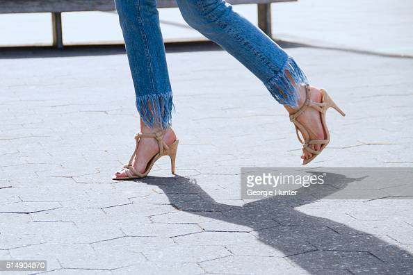 Nicole Craven wearing faded denim jeans with frayed hem by 3x1 and nude strappy sandals by Joe's Jeans on March 11 2016 in New York City