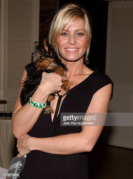 Nicole Eggert with a friend's puppy during Silver Spoon Golden Globes Hollywood Buffet Day 1 at Private Residence in Beverly Hills California United...