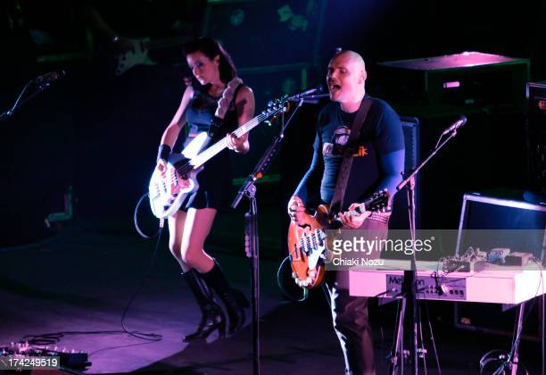 Nicole Fiorentino and Billy Corgan of Smashing Pumpkins perform at Wembley Arena on July 22 2013 in London England