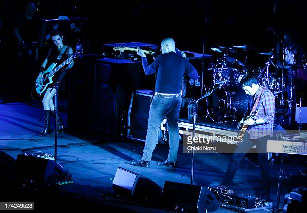 Nicole Fiorentino Billy Corgan and Jeff Schroeder of Smashing Pumpkins perform at Wembley Arena on July 22 2013 in London England