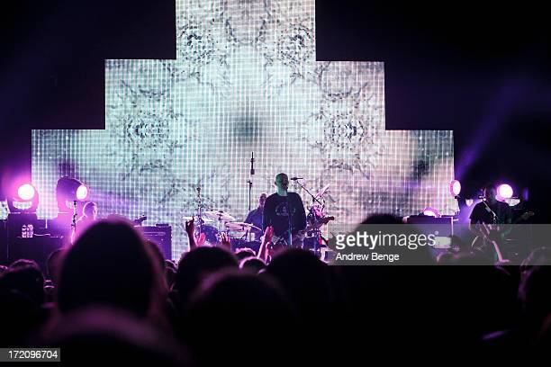 Nicole Fiorentino Billy Corgan Jeff Schroeder and Mike Byrne of The Smashing Pumpkins perform on stage at Manchester Academy on July 1 2013 in...