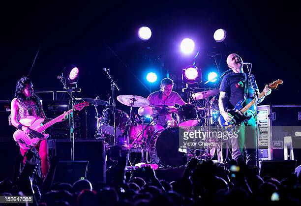 Nicole Fiorentino Billy Corgan Mike Byrne and Jeff Schroeder of The Smashing Pumpkins perform onstage at Arena Ciudad de México on September 22 2012...