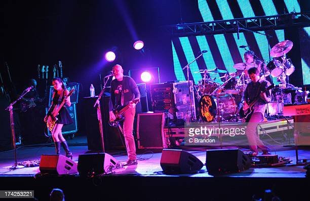 Nicole Fiorentino Billy Corgan Mike Byrne and Jeff Schroeder of The Smashing Pumpkins perform on stage at Wembley Arena on July 22 2013 in London...