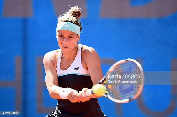 Nicole Gibbs of the United States plays a backhand in her qualifier match against Cindy Burger of Netherlands during Day One of the Nuernberger...