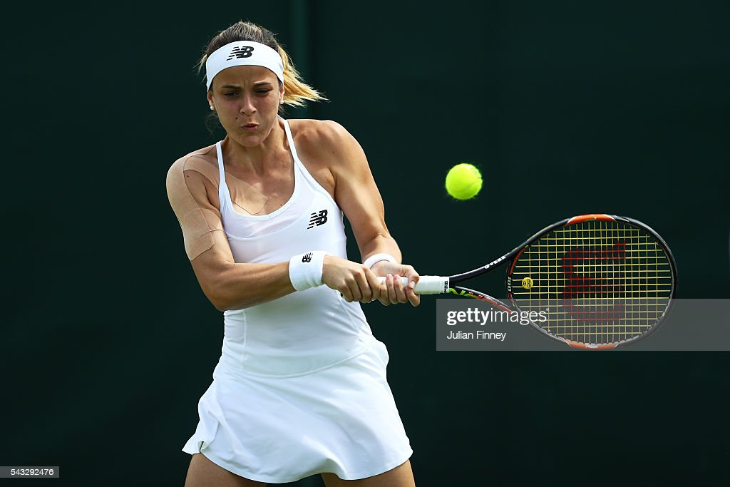 <a gi-track='captionPersonalityLinkClicked' href=/galleries/search?phrase=Nicole+Gibbs&family=editorial&specificpeople=5944661 ng-click='$event.stopPropagation()'>Nicole Gibbs</a> of The United States plays a backhand shot during the Ladies Singles first round match against Kirsten Flipkens of Belgium on day one of the Wimbledon Lawn Tennis Championships at the All England Lawn Tennis and Croquet Club on June 27th, 2016 in London, England.