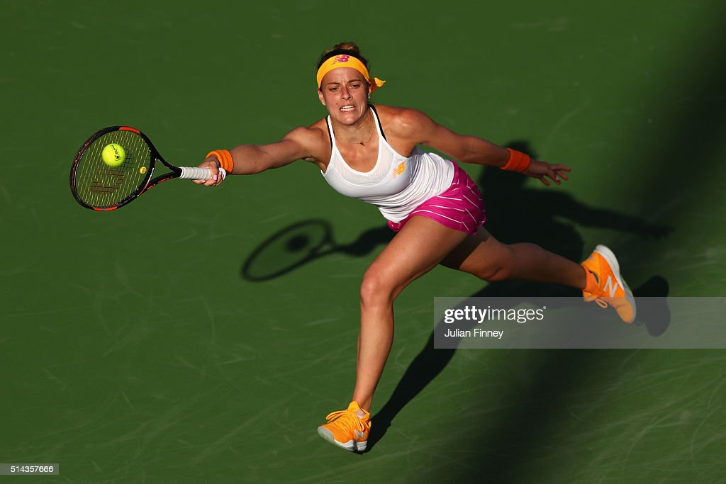 Nicole Gibbs of USA in action against AnnaLena Friedsam of Germany during day two of the BNP Paribas Open at Indian Wells Tennis Garden on March 8...