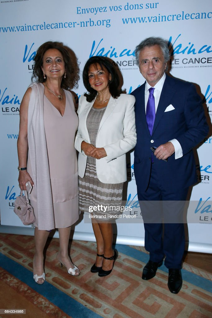 Nicole Guedj standing between President of the 'Vaincre le Cancer' Association, Michel Oks and his wife Julie Oks attend the 'Vaincre Le Cancer' Gala - 30th Anniverary at Cercle de l'Union Interalliee on May 17, 2017 in Paris, France.