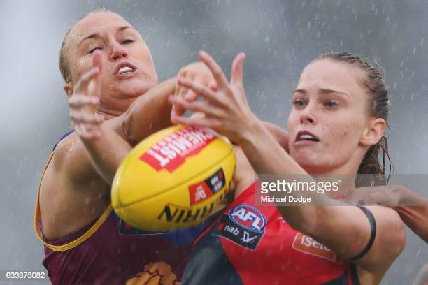 Nicole Hildebrand of the Lions compete for the ball against Madeleine Boyd of the Demons during the round one Women's AFL match between the Melbourne...