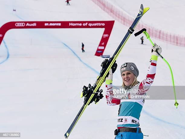 Nicole Hosp of Austria celebrates her third place after the women's FIS Alpine Ski World Cup SuperG in St Moritz on January 25 2015 Lindsey Vonn of...