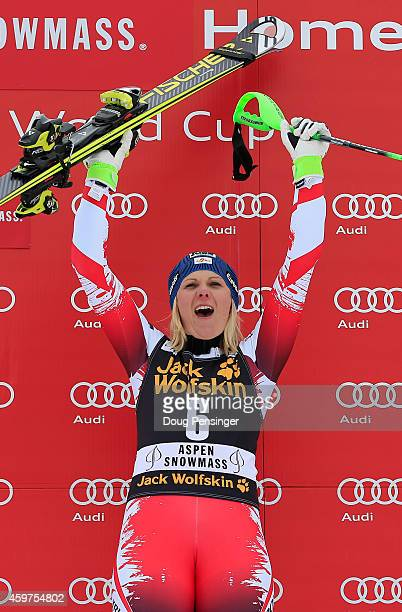 Nicole Hosp of Austria celebrates on the podium after winning the ladies slalom at the 2014 Audi FIS Ski World Cup at the Nature Valley Aspen...
