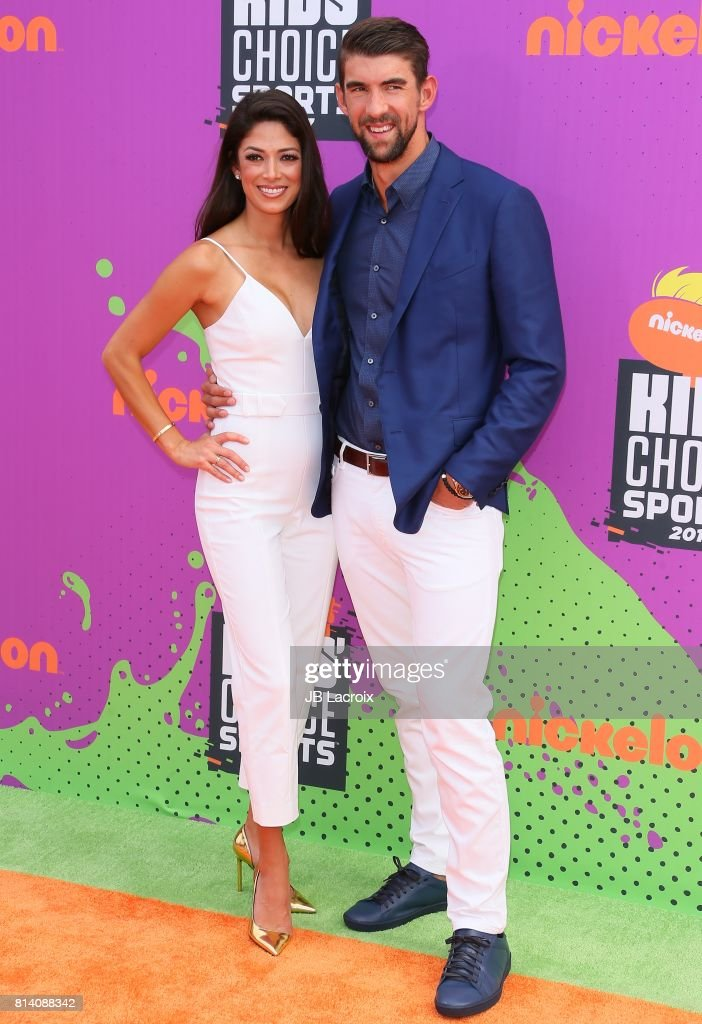 Nicole Johnson and Michael Phelps attend the 2017 Nickelodeon Kids' Choice Sports Awards at Pauley Pavilion on July 13, 2017 in Los Angeles, California.