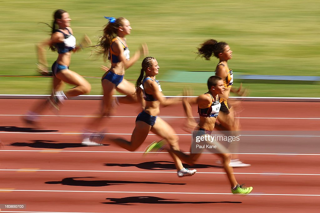 Nicole Kay of Queensland competes in the womens u15 100 metre finals during day six of the Australian Junior Championships at the WA Athletics Stadium on March 17, 2013 in Perth, Australia.