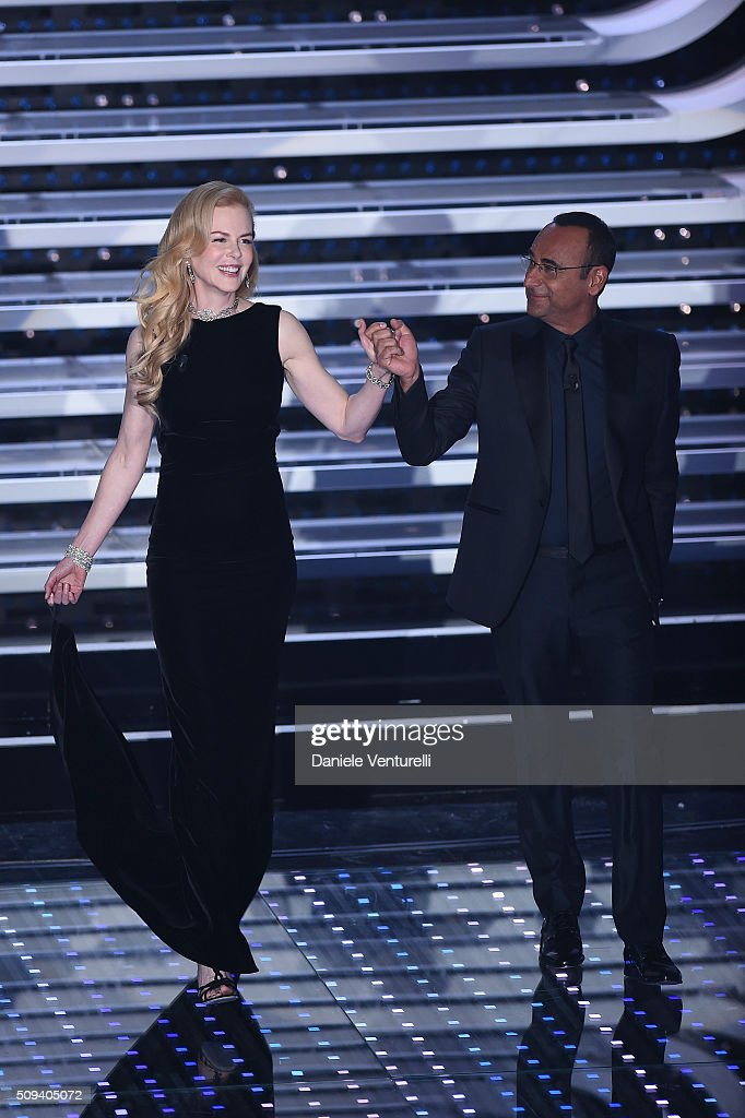 <a gi-track='captionPersonalityLinkClicked' href=/galleries/search?phrase=Nicole+Kidman&family=editorial&specificpeople=156404 ng-click='$event.stopPropagation()'>Nicole Kidman</a> and <a gi-track='captionPersonalityLinkClicked' href=/galleries/search?phrase=Carlo+Conti&family=editorial&specificpeople=4496663 ng-click='$event.stopPropagation()'>Carlo Conti</a> attend second night of the 66th Festival di Sanremo 2016 at Teatro Ariston on February 10, 2016 in Sanremo, Italy.