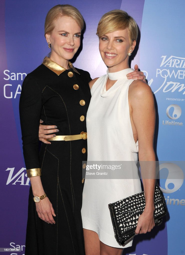 Nicole Kidman and Charlize Theron arrives at the Variety's 5th Annual Power Of Women Event at the Beverly Wilshire Four Seasons Hotel on October 4, 2013 in Beverly Hills, California.