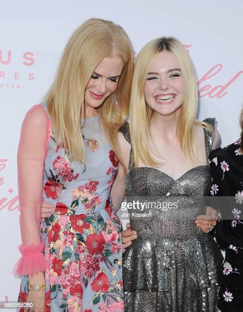 Nicole Kidman and Elle Fanning arrive at the US Premiere Of 'The Beguiled' at Directors Guild Of America on June 12 2017 in Los Angeles California
