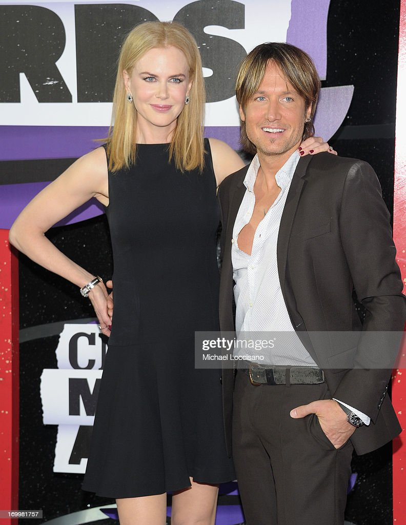 <a gi-track='captionPersonalityLinkClicked' href=/galleries/search?phrase=Nicole+Kidman&family=editorial&specificpeople=156404 ng-click='$event.stopPropagation()'>Nicole Kidman</a> (L) and <a gi-track='captionPersonalityLinkClicked' href=/galleries/search?phrase=Keith+Urban&family=editorial&specificpeople=202997 ng-click='$event.stopPropagation()'>Keith Urban</a> attend the 2013 CMT Music awards at the Bridgestone Arena on June 5, 2013 in Nashville, Tennessee.