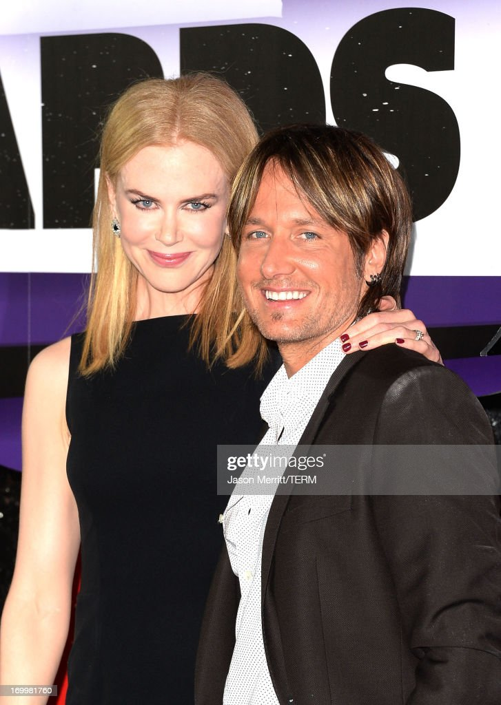 <a gi-track='captionPersonalityLinkClicked' href=/galleries/search?phrase=Nicole+Kidman&family=editorial&specificpeople=156404 ng-click='$event.stopPropagation()'>Nicole Kidman</a> and <a gi-track='captionPersonalityLinkClicked' href=/galleries/search?phrase=Keith+Urban&family=editorial&specificpeople=202997 ng-click='$event.stopPropagation()'>Keith Urban</a> attend the 2013 CMT Music awards at the Bridgestone Arena on June 5, 2013 in Nashville, Tennessee.