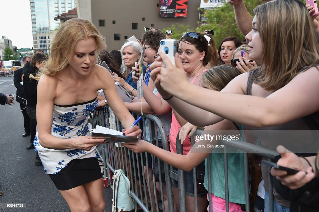 <a gi-track='captionPersonalityLinkClicked' href=/galleries/search?phrase=Nicole+Kidman&family=editorial&specificpeople=156404 ng-click='$event.stopPropagation()'>Nicole Kidman</a> (L) attends the 2014 CMT Music awards at the Bridgestone Arena on June 4, 2014 in Nashville, Tennessee.