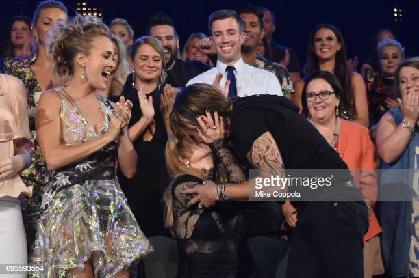 Nicole Kidman congratulates Keith Urban on Best Male Video of the Year award win during the 2017 CMT Music Awards at the Music City Center on June 6...