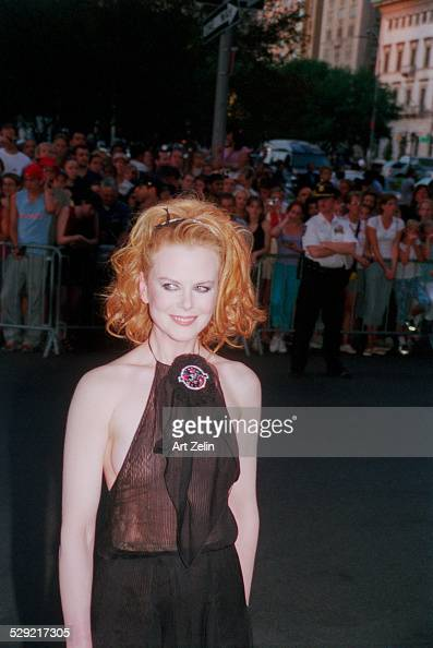 Nicole Kidman in a black formal dress with fans behind the rope line circa 1990 New York