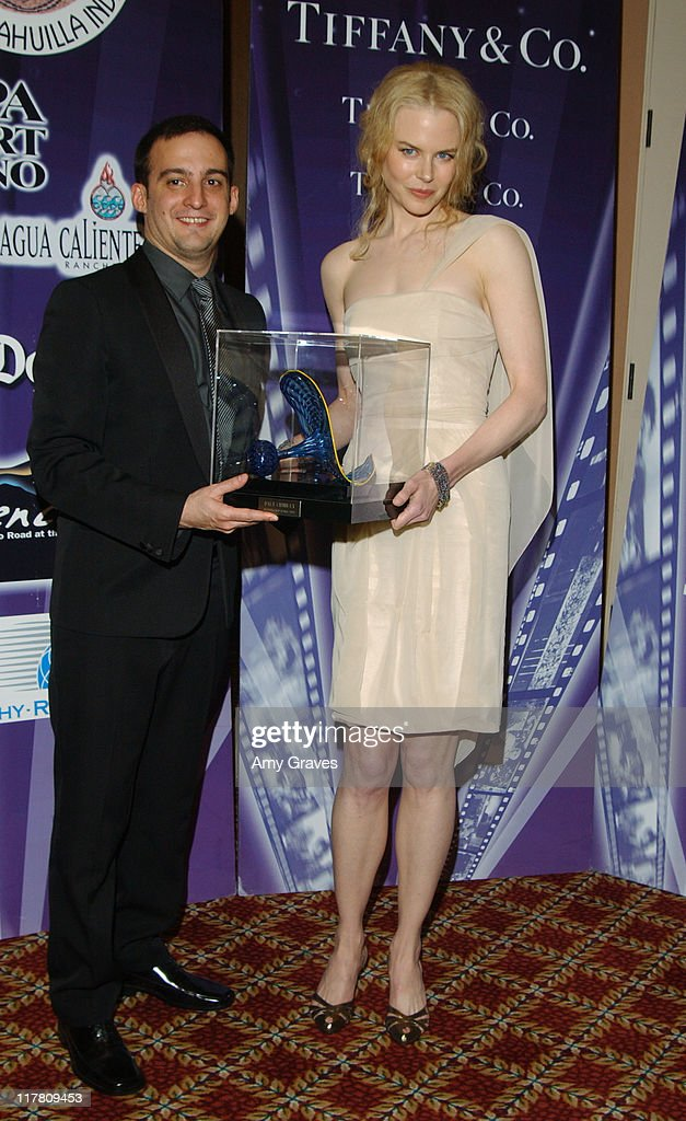 <a gi-track='captionPersonalityLinkClicked' href=/galleries/search?phrase=Nicole+Kidman&family=editorial&specificpeople=156404 ng-click='$event.stopPropagation()'>Nicole Kidman</a>, recipient of the Chairman's Award, and presenter Alejandro Amenebar, director