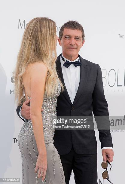 Nicole Kimpel and actor Antonio Banderas arrive for the amfAR 22nd Annual Cinema Against AIDS Gala at Hotel du CapEdenRoc on May 21 2015 in Cap...
