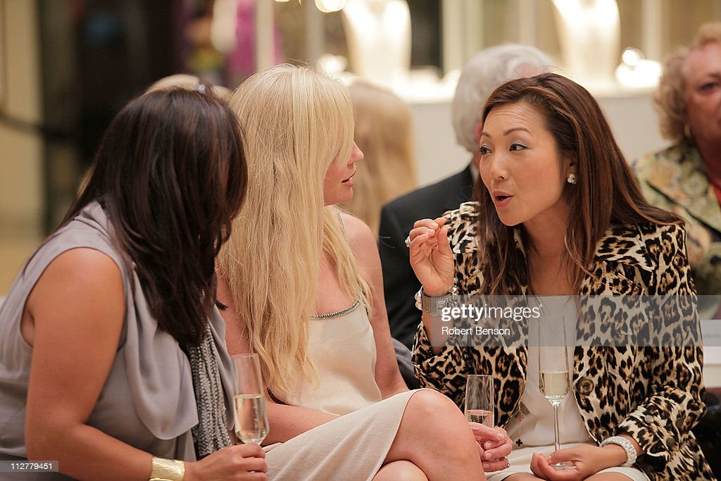 Nicole McMackin (right) talks with guests before a Chloe And Van Cleef & Arpels Fashion Show at South Coast Plaza on April 20, 2011 in Costa Mesa, California.