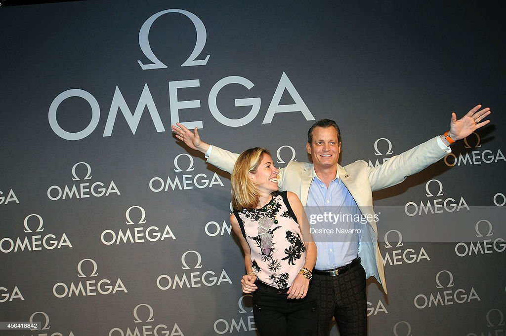 Nicole Mellon (L) and <a gi-track='captionPersonalityLinkClicked' href=/galleries/search?phrase=Matthew+Mellon&family=editorial&specificpeople=584697 ng-click='$event.stopPropagation()'>Matthew Mellon</a> attend the OMEGA Speedmaster Dark Side of the Moon launch at Cedar Lake on June 10, 2014 in New York City.