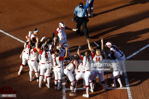 Nicole Mendes of the University of Oklahoma arrives at home plate as her team celebrates scoring against the University of Florida during Game 2 of...