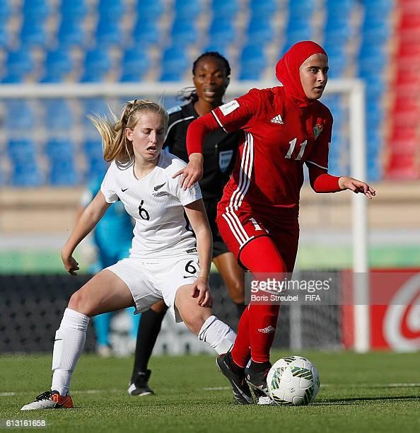 AZ ZARQA' JORDAN OCTOBER 07 Nicole Mettam of New Zealand challenges Tasneem AbuRob of Jordan during the FIFA U17 Women's World Cup Group A match...