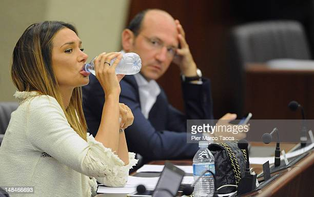 Nicole Minetti drinks water during Lombardy Regional Assembly on July 17 2012 in Milan Italy Angelino Alfano secretary of People of Freedom Party has...