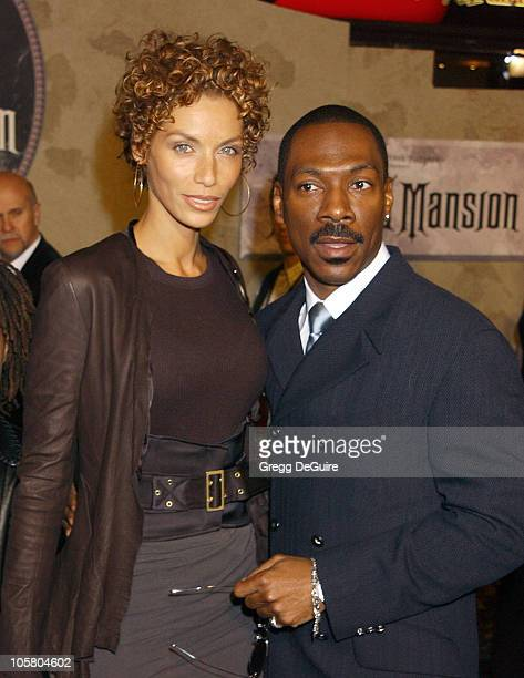 Nicole Murphy and Eddie Murphy during 'The Haunted Mansion' World Premiere at El Capitan Theatre in Hollywood California United States