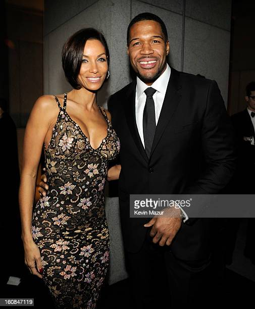 Nicole Murphy and Michael Strahan attend the amfAR New York Gala To Kick Off Fall 2013 Fashion Week at Cipriani Wall Street on February 6 2013 in New...