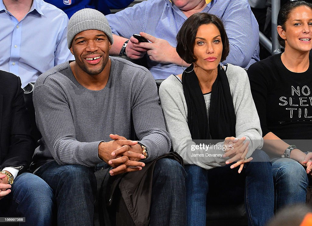 Nicole Murphy and <a gi-track='captionPersonalityLinkClicked' href=/galleries/search?phrase=Michael+Strahan&family=editorial&specificpeople=210563 ng-click='$event.stopPropagation()'>Michael Strahan</a> (L) attend the New York Knicks v Brooklyn Nets game at Barclays Center on November 26, 2012 in the Brooklyn borough of New York City.