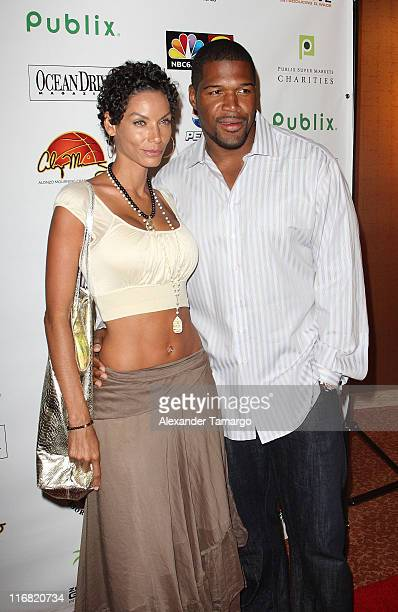 Nicole Murphy and Michael Strahan poses at Zo's Summer Groove Beach Ball at Hotel Intercontinental on July 11 2008 in Miami Florida