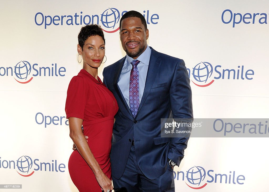 Nicole Murphy and tv personality <a gi-track='captionPersonalityLinkClicked' href=/galleries/search?phrase=Michael+Strahan&family=editorial&specificpeople=210563 ng-click='$event.stopPropagation()'>Michael Strahan</a> attend Operation Smile's Smile Event at Cipriani Wall Street on May 1, 2014 in New York City.