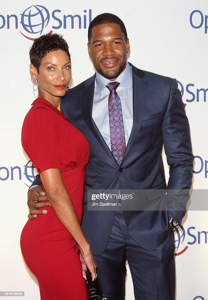 Nicole Murphy and tv personality <a gi-track='captionPersonalityLinkClicked' href=/galleries/search?phrase=Michael+Strahan&family=editorial&specificpeople=210563 ng-click='$event.stopPropagation()'>Michael Strahan</a> attend the Operation Smile's Smile Event at Cipriani Wall Street on May 1, 2014 in New York City.