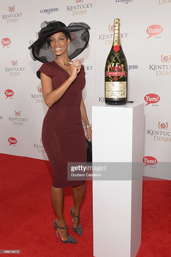 Nicole Murphy toasts with Moet & Chandon at the 140th Kentucky Derby at Churchill Downs on May 3, 2014 in Louisville, Kentucky.
